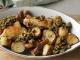 Geroosterde aardpeer met kippendij en relish van ansjovis, walnoot en peterselie op schaal